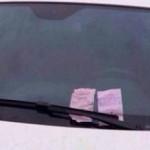 中国の駐禁切符の裏のお巡りさんのメモ
