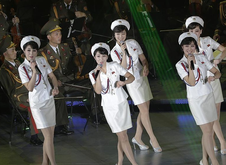 Singers from the Moranbong band and musicians from the State Merited Chorus perform in Pyongyang, North Korea, Sunday, Oct. 11, 2015. The performance was part of the 70th anniversary celebrations of the founding of the ruling Workers' Party. (AP Photo/Wong Maye-E)