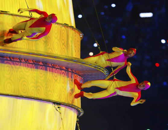 Performers take part in the opening ceremony of the Beijing 2008 Olympic Games at the National Stadium, August 8, 2008. The stadium is also known as the Bird's Nest. REUTERS/Mike Blake (CHINA)