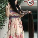 中国の長すぎる髪の民族チックな女性たち