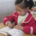 中国で行われている子どもが学習中の姿勢を正すための方法